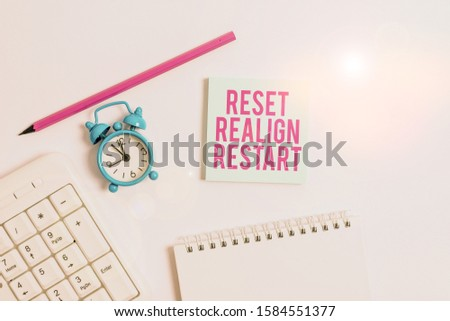 Handwriting text writing Reset Realign Restart. Concept meaning Life audit will help you put things in perspectives White pc keyboard with empty note paper and pencil above white background. #1584551377