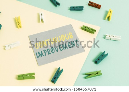 Conceptual hand writing showing Continuous Improvement. Business photo showcasing ongoing effort to improve products or processes Colored clothespin paper reminder with yellowblue background. #1584557071