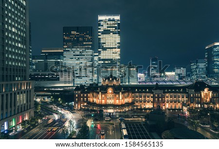 Beautiful urban cityscape with Tokyo station under twilight sky and neon night in Marunouchi business district, Japan Royalty-Free Stock Photo #1584565135