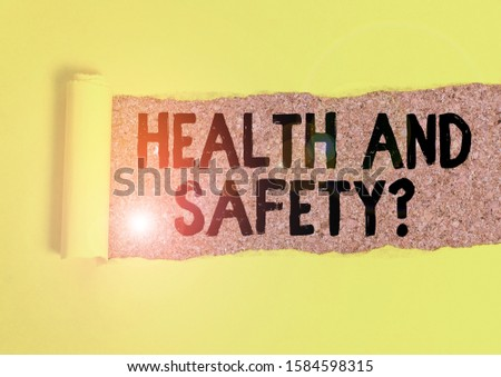 Word writing text Health And Safety Question. Business concept for regulations and procedures to prevent accident or injury Cardboard which is torn in the middle placed above a wooden classic table. #1584598315