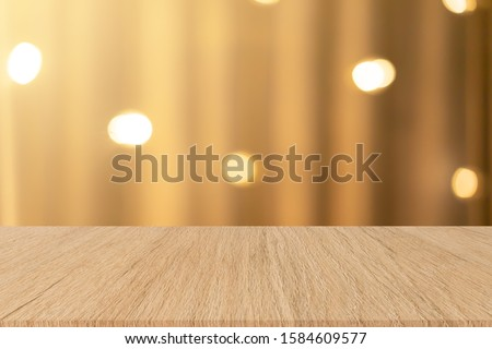 abstract blur sepia and brown tone color curtain with LED light stage background and aged wood perspective tabletop for show,ads,design product on display concept in merry xmas and happy new year 2020 #1584609577