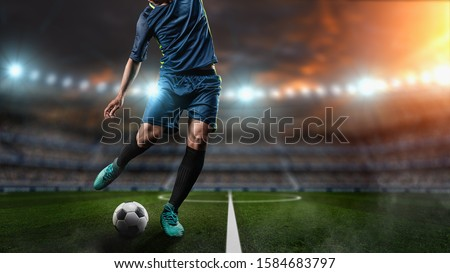 Soccer player kicks the ball on the soccer field.Professional soccer player in action. #1584683797