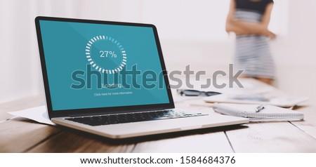 Close up of freelancer laptop screen with loading bar, young woman waiting impatiently on background, slow connection, computer software concept Royalty-Free Stock Photo #1584684376