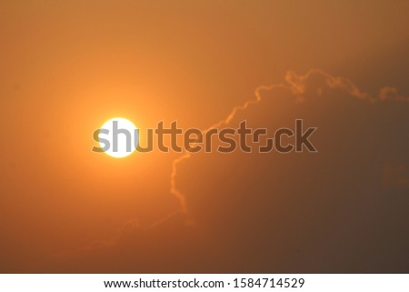 "Keep your face to the sun and you will never see the shadows."" sun in evening time. #Dawn #sun #yellow #clouds #beautiful #dusk #red #shape #attractive #round #pic #click #view #bright #background"