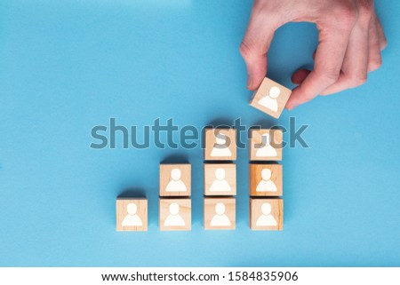 Hand adding a new team member to a group. Business management concept Royalty-Free Stock Photo #1584835906