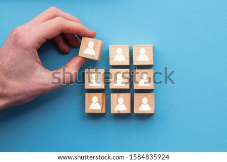 Hand adding a new team member to a group. Business management concept Royalty-Free Stock Photo #1584835924