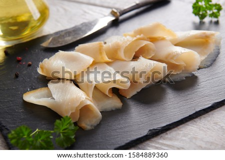 Delicious smoked halibut slices close up