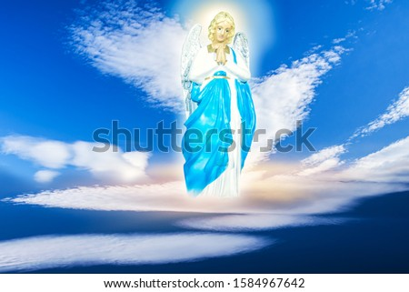 Angel in the clouds . Blue sky with clouds . religion background #1584967642