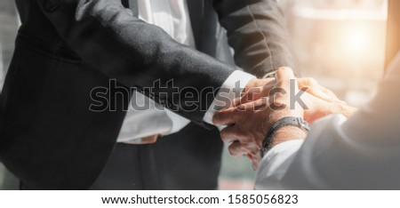 business background of businessman hands holding hands with other in happy conclusion of business deal #1585056823
