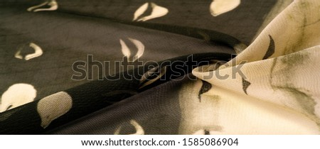 Background texture. Women's olive-colored scarf #1585086904