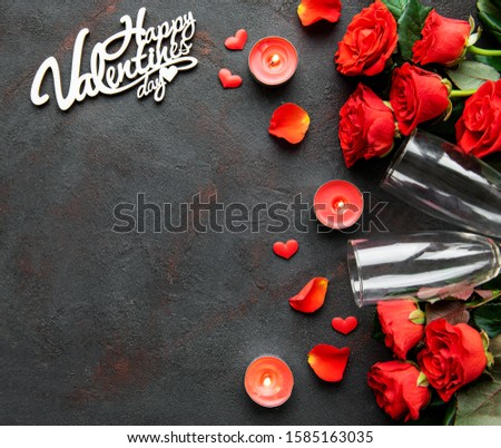 Valentines day romantic background - red roses, glasses, candle and hearts. Flat lay, copy space.  #1585163035