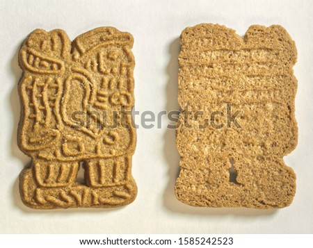 Natural food. Figured cookies from whole grains. Front view and rear view of matrix cookies with a relief image on a fairy-tale theme on a white paper background. #1585242523