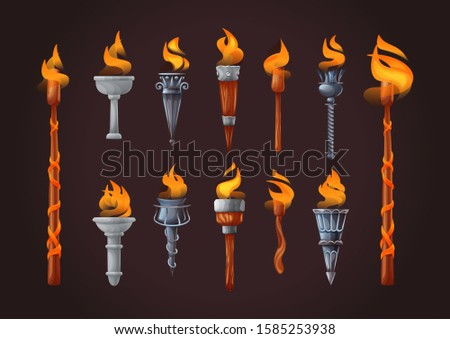 Medieval torch with burning fire set on dark background. Ancient realistic metal and wooden torches differents shapes with burned fire flame elements for the game cartoon vector illustration