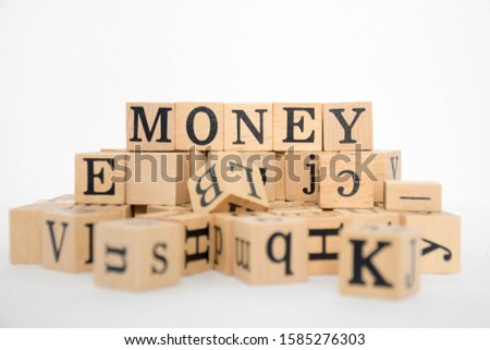 Word Money on wooden cubes.white background. #1585276303
