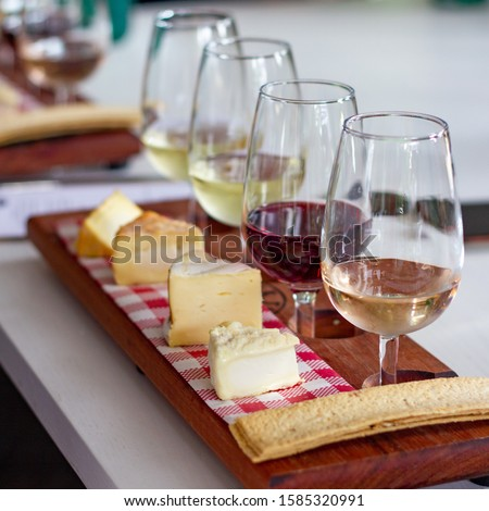 Paired wine and cheese flight Royalty-Free Stock Photo #1585320991