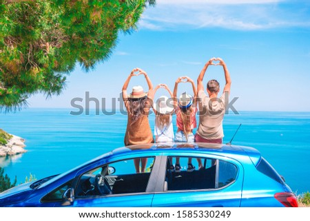 Parents and two little kids on summer car vacation #1585330249