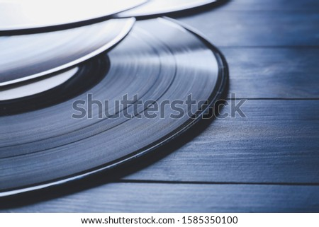 Vinyl disks for record player on color wooden background, closeup #1585350100