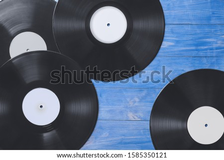 Vinyl disks for record player on color wooden background #1585350121