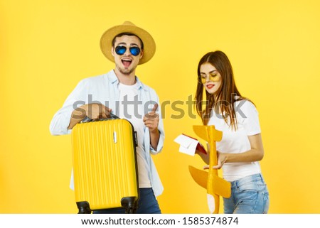 Cheerful men woman with suitcases in hands travel vacation vacation #1585374874