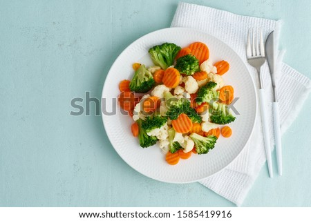 Mix of boiled vegetables. Broccoli, carrots, cauliflower. Steamed vegetables for dietary low-calorie diet. FODMAP, dash diet, vegan, vegetarian, top view, copy space #1585419916
