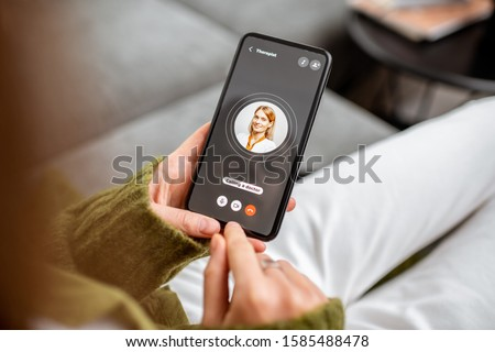 Woman making video call to a doctor using digital tablet, feeling bad at home. Concept of telemedicine and patient counseling online Royalty-Free Stock Photo #1585488478