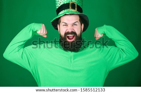Global celebration. Man bearded hipster wear hat. Saint patricks day holiday. Green part of celebration. Happy patricks day. St patricks day holiday known for parades shamrocks and all things Irish. #1585512133