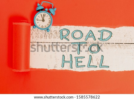 Handwriting text writing Road To Hell. Concept meaning Extremely dangerous passageway Dark Ri Unsafe travel Alarm clock and torn cardboard placed above a wooden classic table backdrop. #1585578622