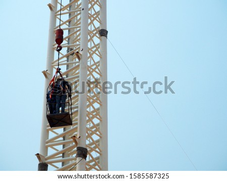 Man Working on the Working at height in construction site #1585587325
