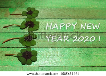Happy new year wishes with lucky clover #1585631491
