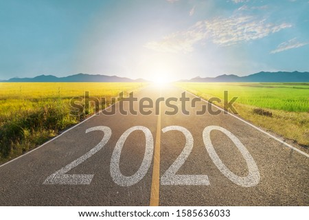 2020 write on road with sun light at the end of way metaphor New planning on next year, Goals to success concept. #1585636033