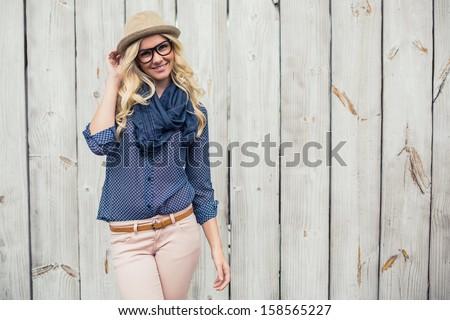 Smiling trendy model posing on wooden background #158565227