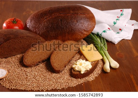 Rye bread. Rye bread with ingredients on a wooden table. #1585742893