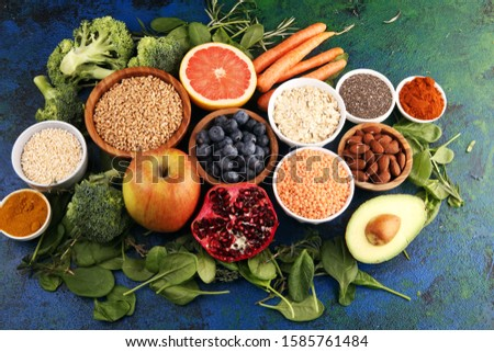 Healthy food clean eating selection: fruit, vegetable, seeds, superfood, cereals, leaf vegetable on background #1585761484