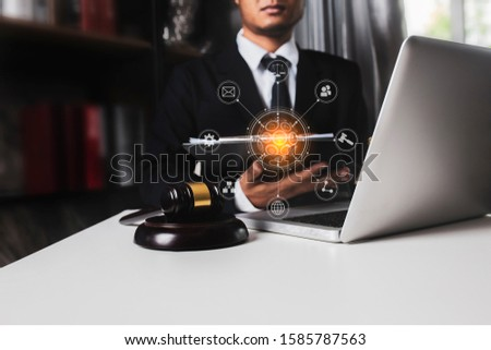 Lawyer holding the envelope and working on wood table at coffee with law interfaces icon. #1585787563