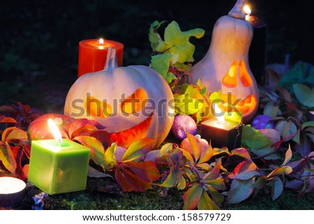 Halloween pumpkin lanterns with autumn leaves and candies #158579729