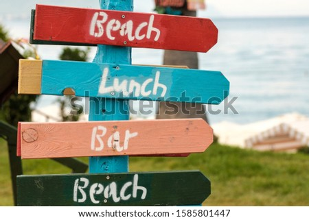 signs where is the beach and bar of different colors. funny pointers colorful #1585801447