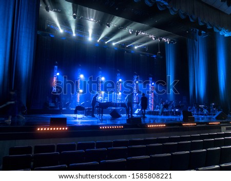 lighting equipment at concert - colored spotlights on ceiling in smoke, leaving room for showcased content. #1585808221