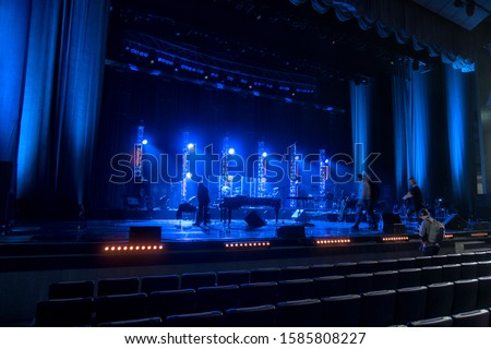 lighting equipment at concert - colored spotlights on ceiling in smoke, leaving room for showcased content. #1585808227