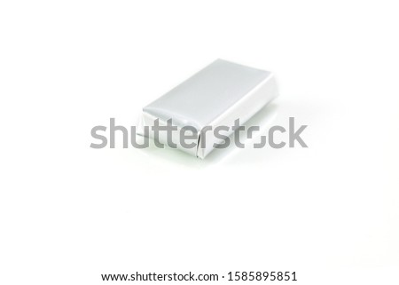 Small chocolate bar in silver paper wrap isolated on white #1585895851