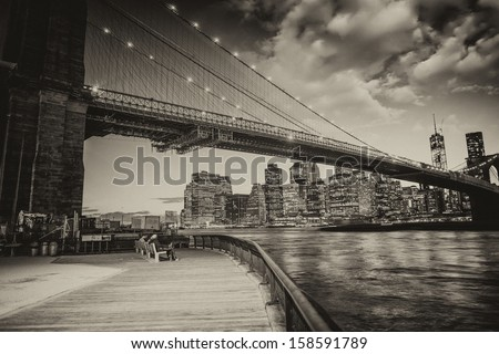 Manhattan skyline with East river reflections at night. Royalty-Free Stock Photo #158591789