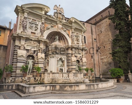 Gorgeous Fountain of the Organ or Fontana dell'Organo, which play four pieces of late Renaissance music. Water Organ with Castellum aqua or water castle behind it, in the gardens at the Villa d'Este #1586031229