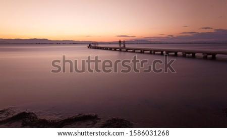 Amazing and peacefull orange sunset with a nice wooden bridge. #1586031268