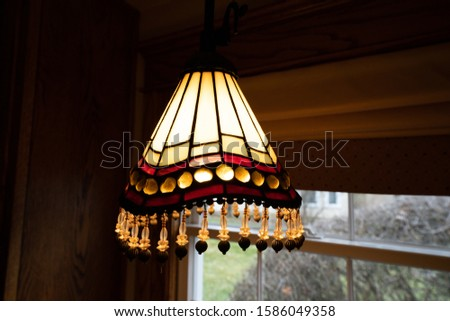 stained glass light fixture glows brightly #1586049358