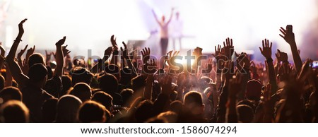 crowd with raised hands at concert festival banner #1586074294