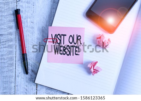 Text sign showing Visit Our Website. Conceptual photo visitor who arrives at web site and proceeds to browse Thick pages notebook stationary placed above classic look wooden backdrop. #1586123365