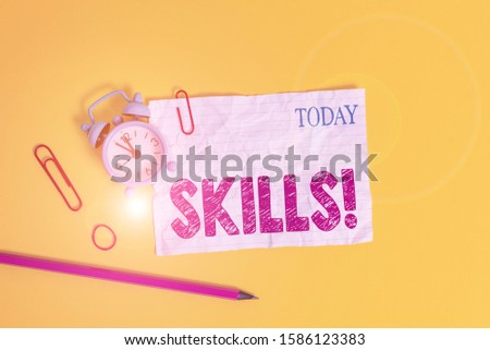 Word writing text Skills. Business concept for ability do something very well by nature Alarm clock clips crushed note rubber band pencil colored background. #1586123383