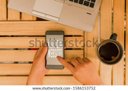 Text sign showing Visit Our Website. Conceptual photo visitor who arrives at web site and proceeds to browse woman computer smartphone drink mug office supplies technological devices. #1586153752