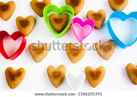Heart shaped cookies on a white background with plastic shapes #1586205391