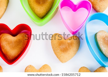 Heart shaped cookies on a white background with plastic shapes #1586205712