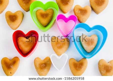 Heart shaped cookies on a white background with plastic shapes #1586205958
